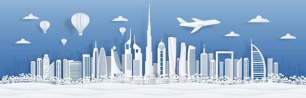 Вырезанный из бумаги дубай. панорама города оаэ на фоне линии горизонта с известными достопримечательностями для открыток и плакатов