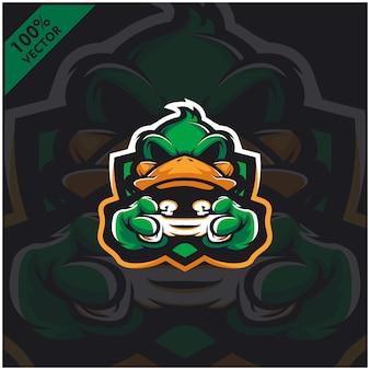 Утка геймер держит игровую приставку джойстик. дизайн логотипа талисмана для команды киберспорта.