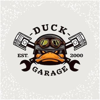 ダックヘッドの自動修理とカスタムガレージのロゴ。