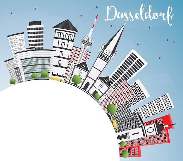 灰色の建物と青い空とコピースペースのあるデュッセルドルフのスカイライン