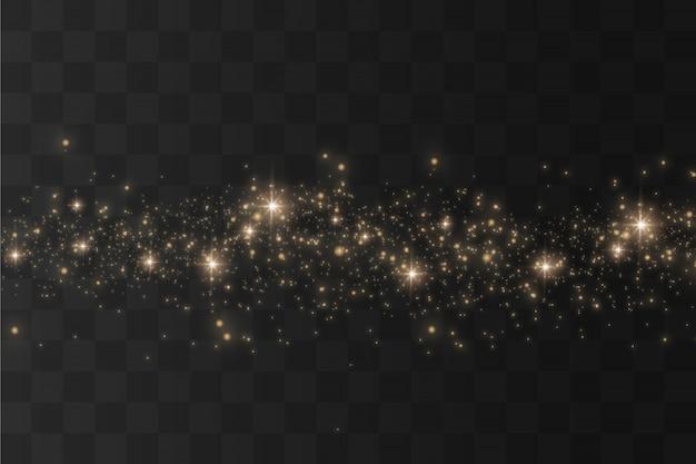 透明な背景にほこり。ほこりの火花と金色の星が特別な光で輝きます。星が飛んで、透明な背景の上で輝きます。クリスマスライト効果。
