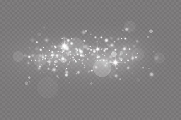 ほこりの火花と星が特別な光で輝きますクリスマスライト効果キラキラ光る粒子