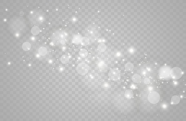 The dust sparks and golden stars shine with special light.  sparkles on a transparent background. christmas light effect. sparkling magical dust particles.