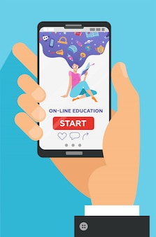 画面上の教育的なアプリで携帯電話を持っている男性の手。遠いeラーニング