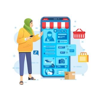 スマホのeコマースオンラインショップアプリ、スマホからオンラインでヒジャーブショッピングをする女性
