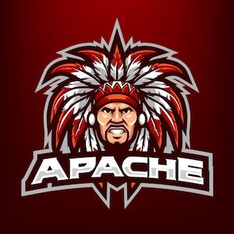 濃い赤の背景に分離されたスポーツとeスポーツのロゴのチーフアパッチヘッドマスコットイラスト