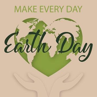 緑の惑星地球とアースデイのバナー。地球儀を注意深く握る手。図