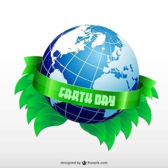 Earth day with a planet and green leaves