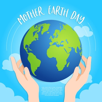 Earth in hands on sky blue background
