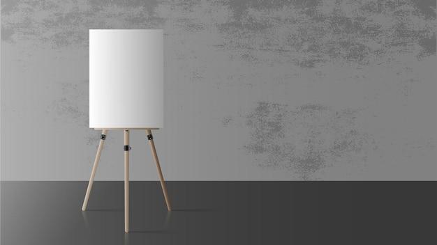 空の部屋のイーゼル。木製イーゼル。コンクリートの灰色の壁。現実的。