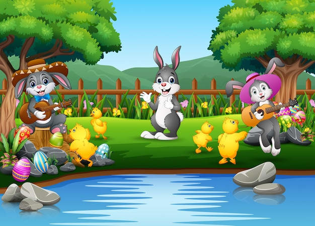 Easter background with bunnies and baby chick on the nature