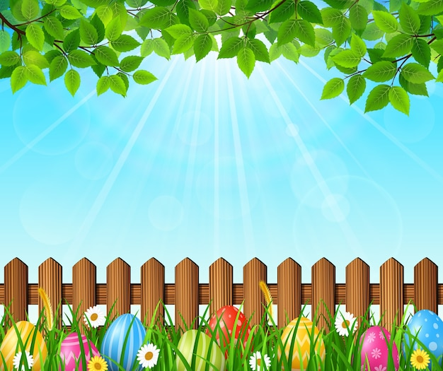 Easter background with colorful eggs in the grass