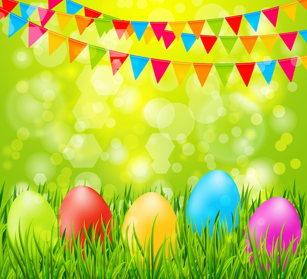 緑の草と旗のカラフルな卵とイースターの背景