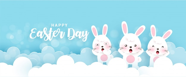 Easter banner with cute rabbits  in paper cut and craft style .