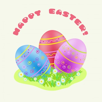 Easter blue; red; purple painted egg in green grass