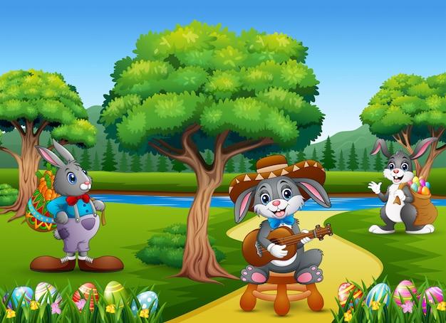 Пасхальные кролики и пасхальное яйцо на природе
