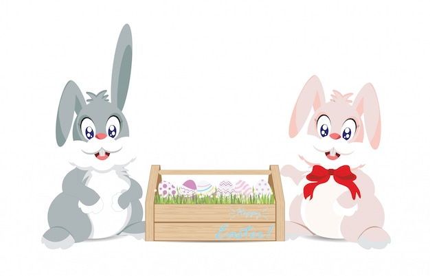 Easter bunnies and easter eggs in wooden box for decoration