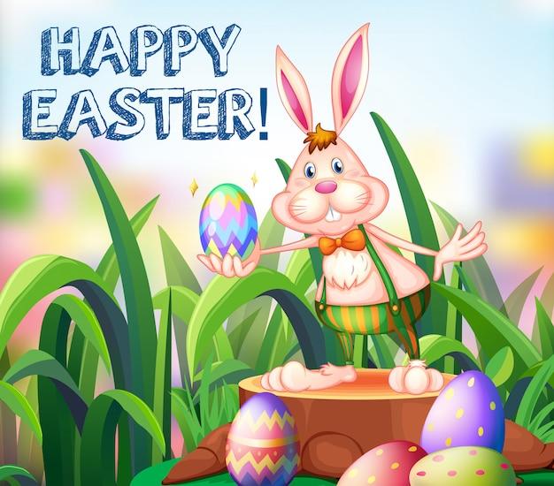 Пасхальный заяц и украшенные яйца в саду