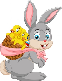 Easter bunny carrying basket of baby chicks