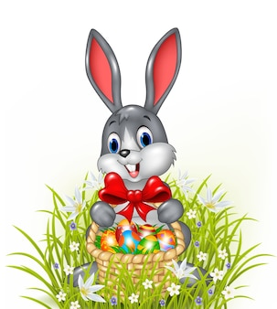 A easter bunny with a basket of painted easter eggs