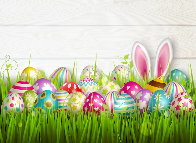 Easter composition with colourful images of festive easter eggs on green grass surface with bunny ears  illustration