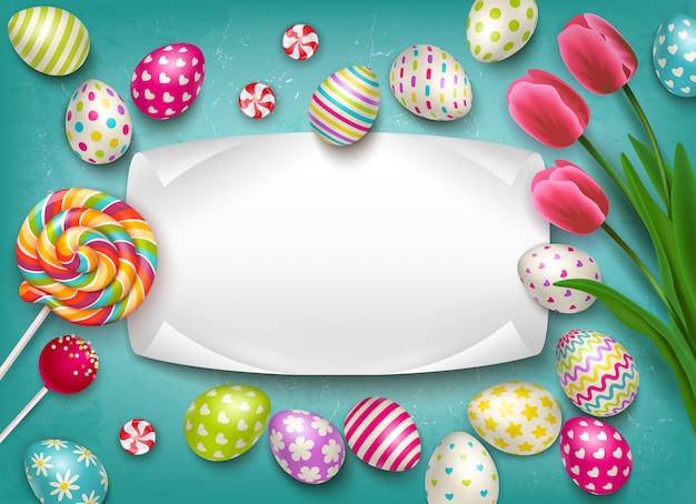 Пасхальная композиция с изображением цветных праздничных яиц, конфет и цветов с пустой текстовой рамкой