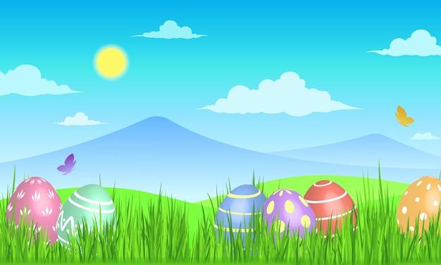 日当たりの良い草原の背景にイースターエッグ。美しい景色