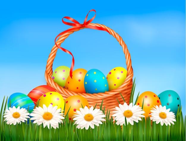 부활절 달걀과 잔디에 바구니와 꽃