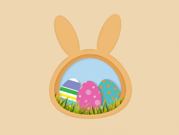 Easter eggs and grass in bunny shape frame