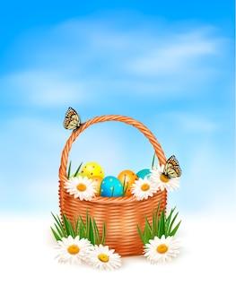 부활절 달걀 바구니와 꽃에 나비