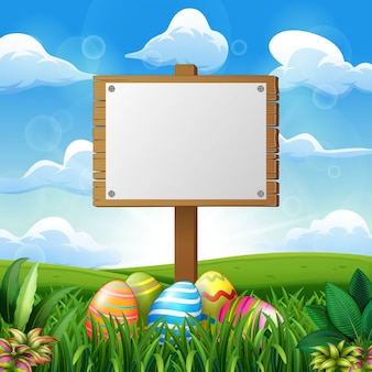 Easter eggs with blank wooden board