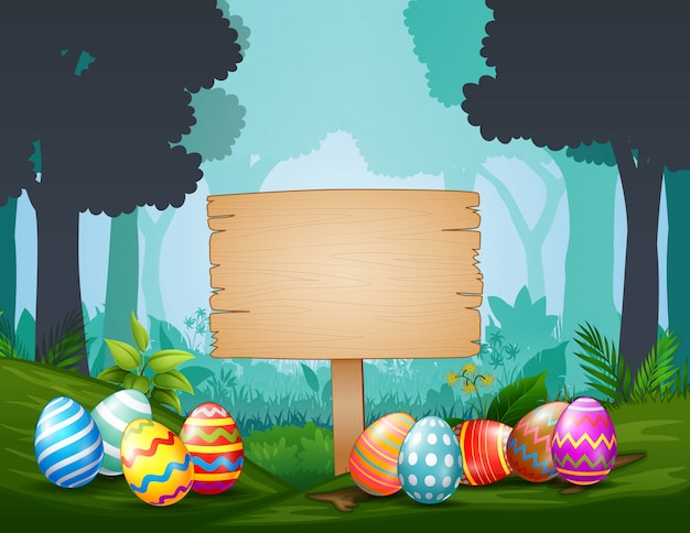 Easter eggs with wooden sign  in the middle of dark forest