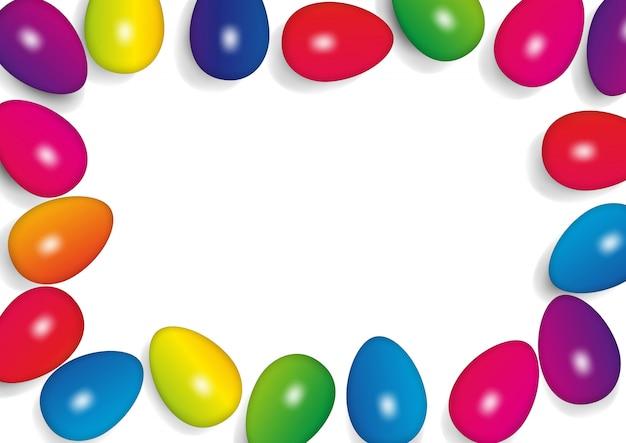 多色の卵とイースターフレームの背景