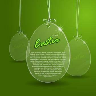 緑の背景にイースターガラスの卵