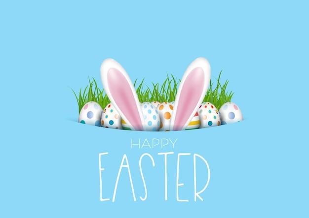 Biglietto di auguri di pasqua con uova e orecchie da coniglio