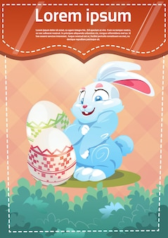Easter rabbit hold decorated colorful egg holiday symbols greeting card