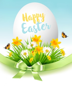 Easter sale background. holiday egg in green grass and flowers.