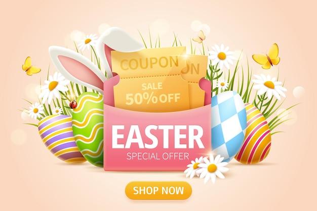 분홍색 봉투에 쿠폰이 있는 부활절 판매 팝업 광고와 풀밭에 있는 부활절 달걀