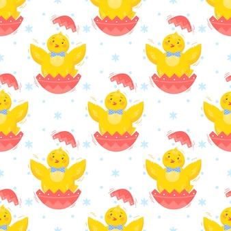 イースターのシームレスなパターン。かわいい小さな雛。イースター休暇の装飾的な背景