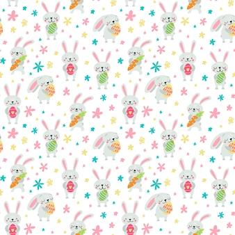 パステルカラーのシームレスなパターンのイラストでウサギ、卵、花とイースタースタイル Premiumベクター