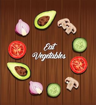 木製の背景で周りの健康食品と野菜のレタリングポスターを食べる