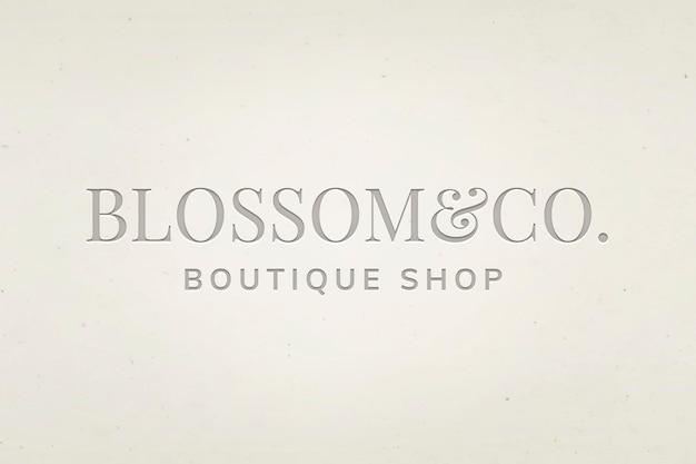 Vettore modificabile del logo aziendale boutique con testo in fiore e co