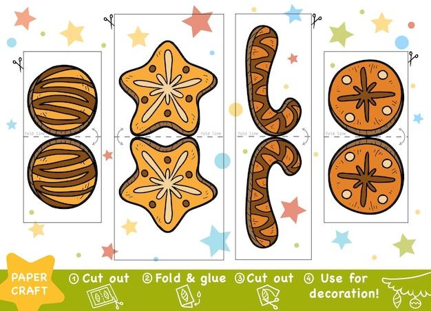 어린이를 위한 교육 크리스마스 종이 공예 쿠키 가위와 풀을 사용하여 이미지 만들기