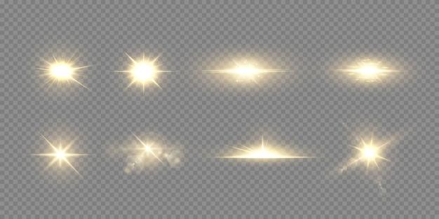 エフェクト、レンズフレア、輝き、爆発、金色の光、セット。輝く星、美しい金色の光線。