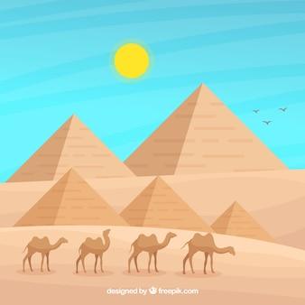 Egypt landscape concept with pyramids and caravan