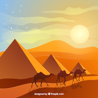 Egypt landscape with caravan and pyramids