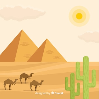 Egypt landscape with pyramids and caravan