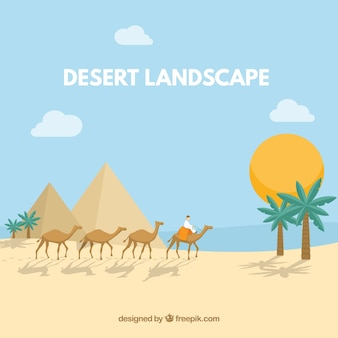 Egyptian desert landscape with pyramids and caravan