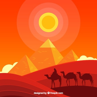 Egyptian pyramids landscape with caravan of camels
