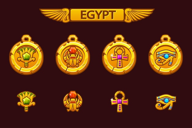 Egyptian talismans with scarab, eye, flower and cross. olden egypt golden amulet with colored precious gems.